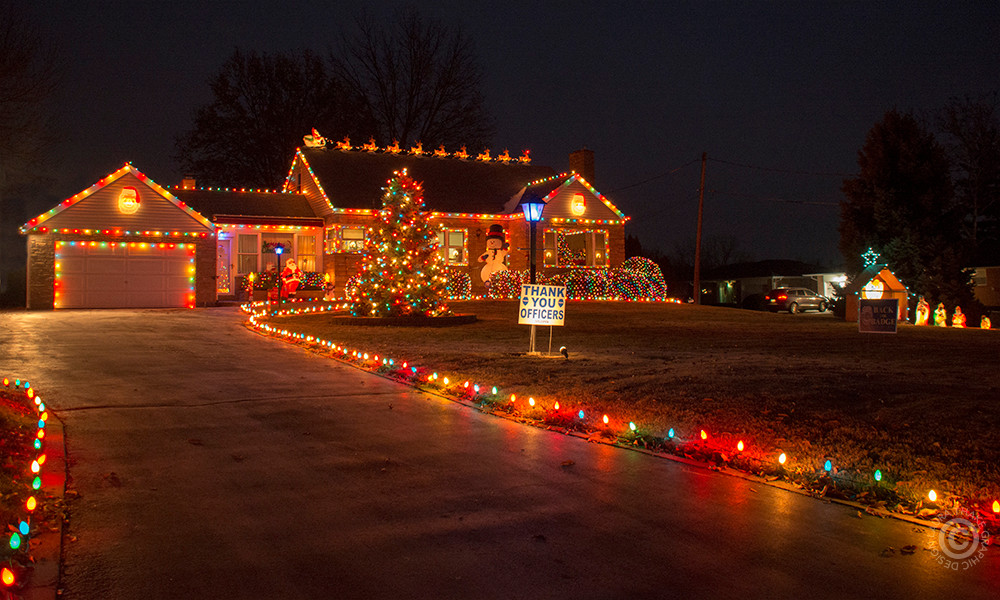 Old fashioned Christmas lights on a house in Affton MO.