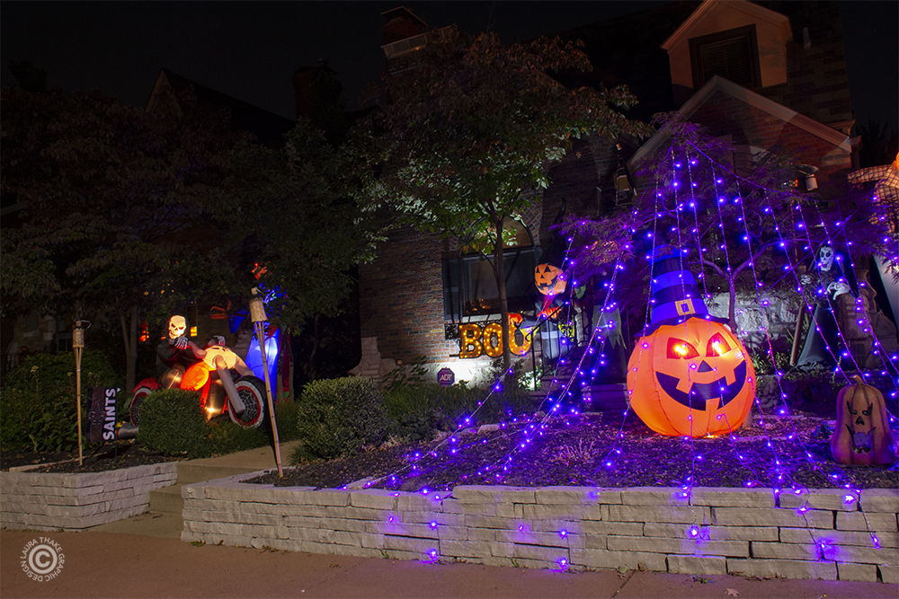 Purple Halloween lights in a spider web shape.