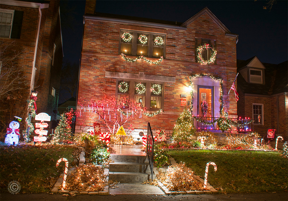 Christmas wreathes and lights decorating a house in St. Louis Hills.