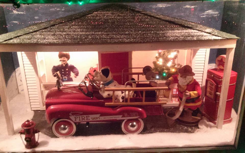 Santa is a fireman in this Christmas decoration.