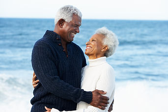 Romantic Senior Couple Hugging On Beach.