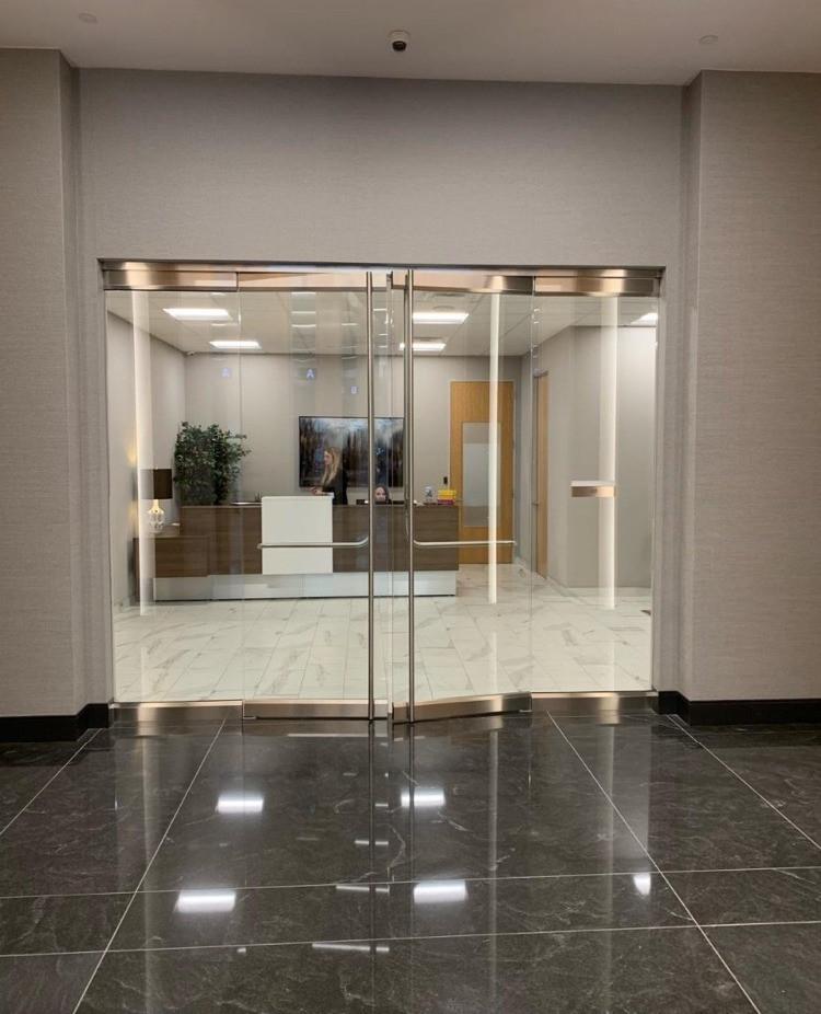 Doors to office of Frisco, Texas branch of EnTrust Funding