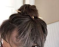 Bun with hair sticks.jpg