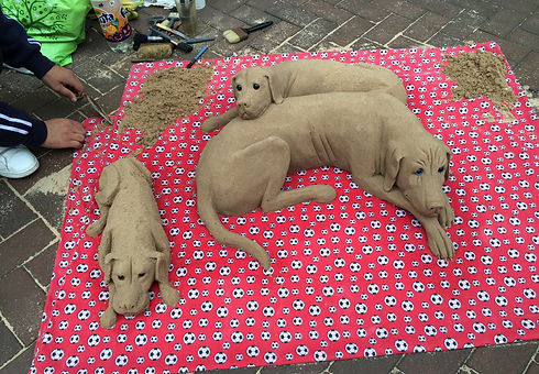 Sand sculptures of dogs