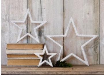 Set of three white mantlepiece stars
