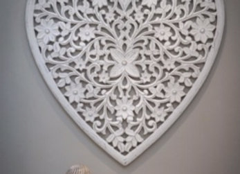 Large white heart shaped hand carved wooden wall panel