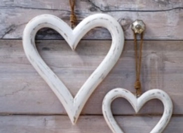 Pair of large white wooden hearts on a rope