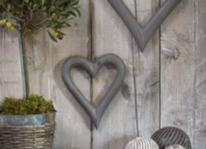 Pair of large grey wooden hearts on a rope