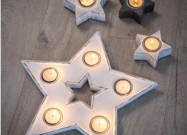 White hand finished star shaped multi tealight holder