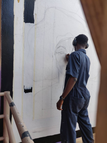 Sule drawing the initial sketch