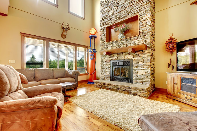 Living Room With High Ceiling, Stone Fireplace And Leather Sofa..jpg