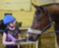 Ava reading to horse