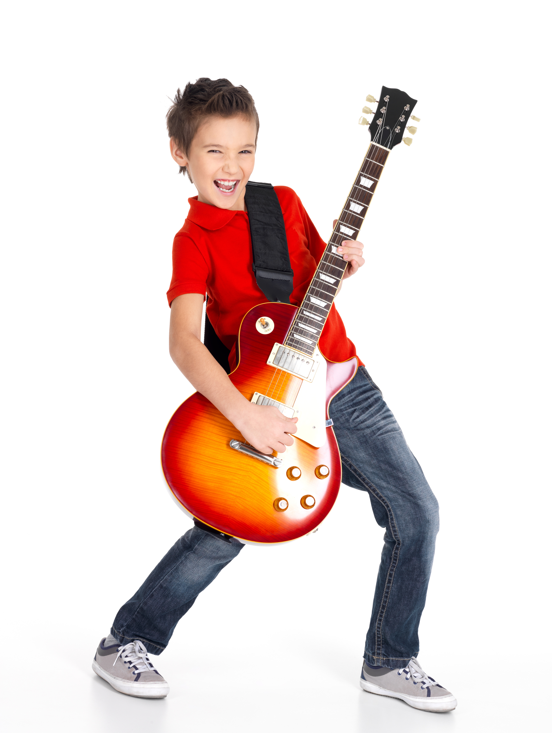A young white boy sings and plays on the electric guitar with bright emotions, isolated on white bac