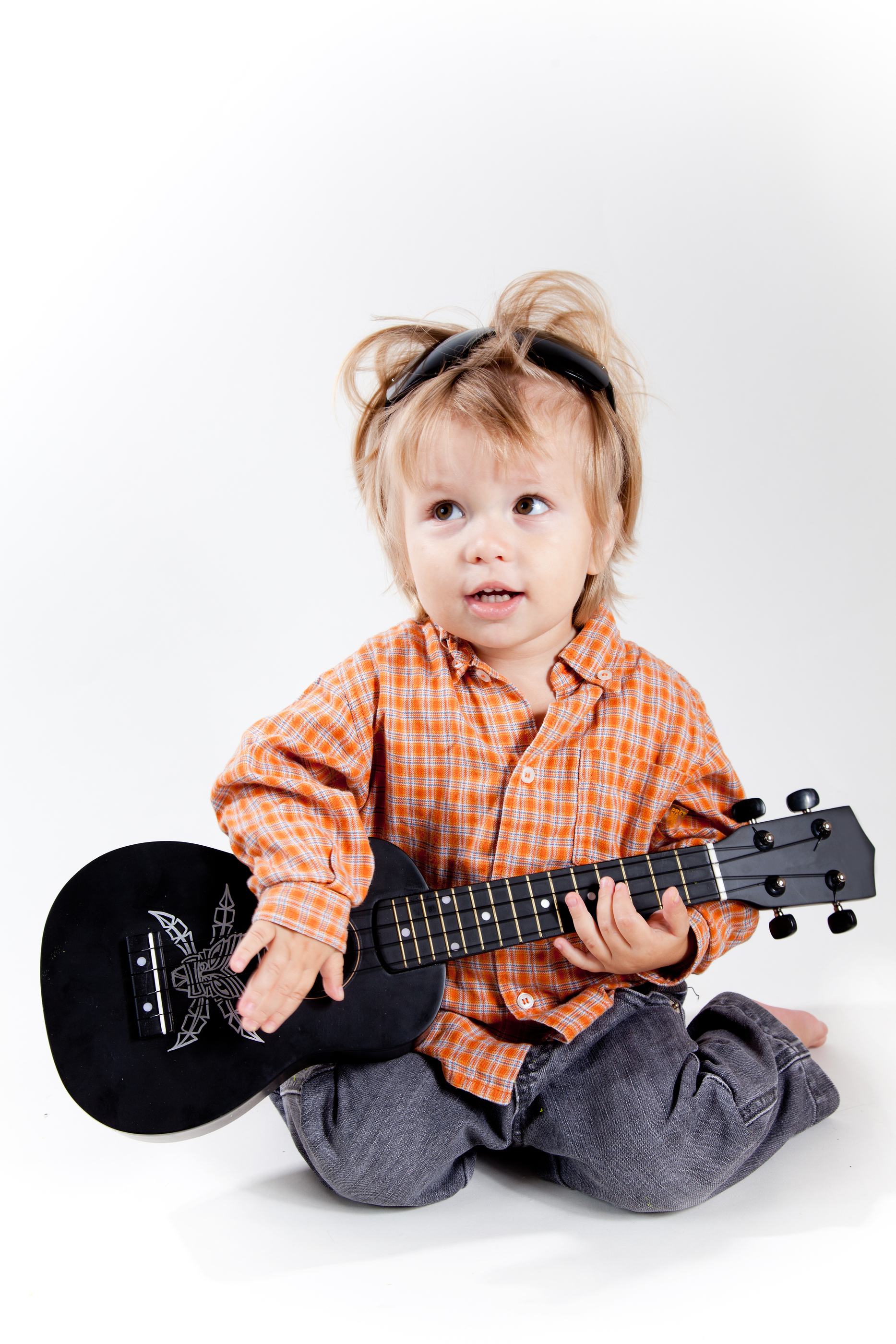 Cute Little Boy Playing Ukulele Guitar