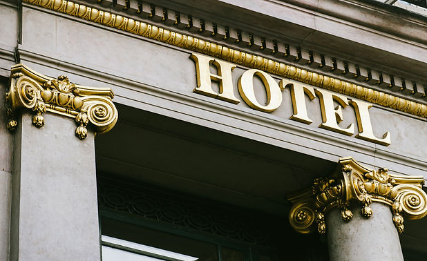 Hotel word with golden letters on luxury