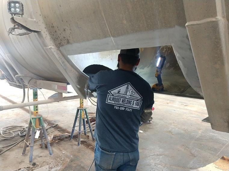 Andrew Repairing Inside of Tanker.jpg