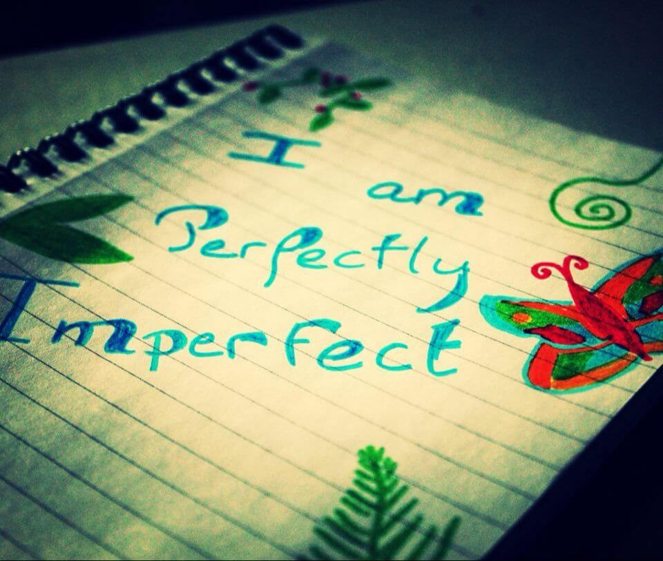 I am perfectly imperfect written in a notebook