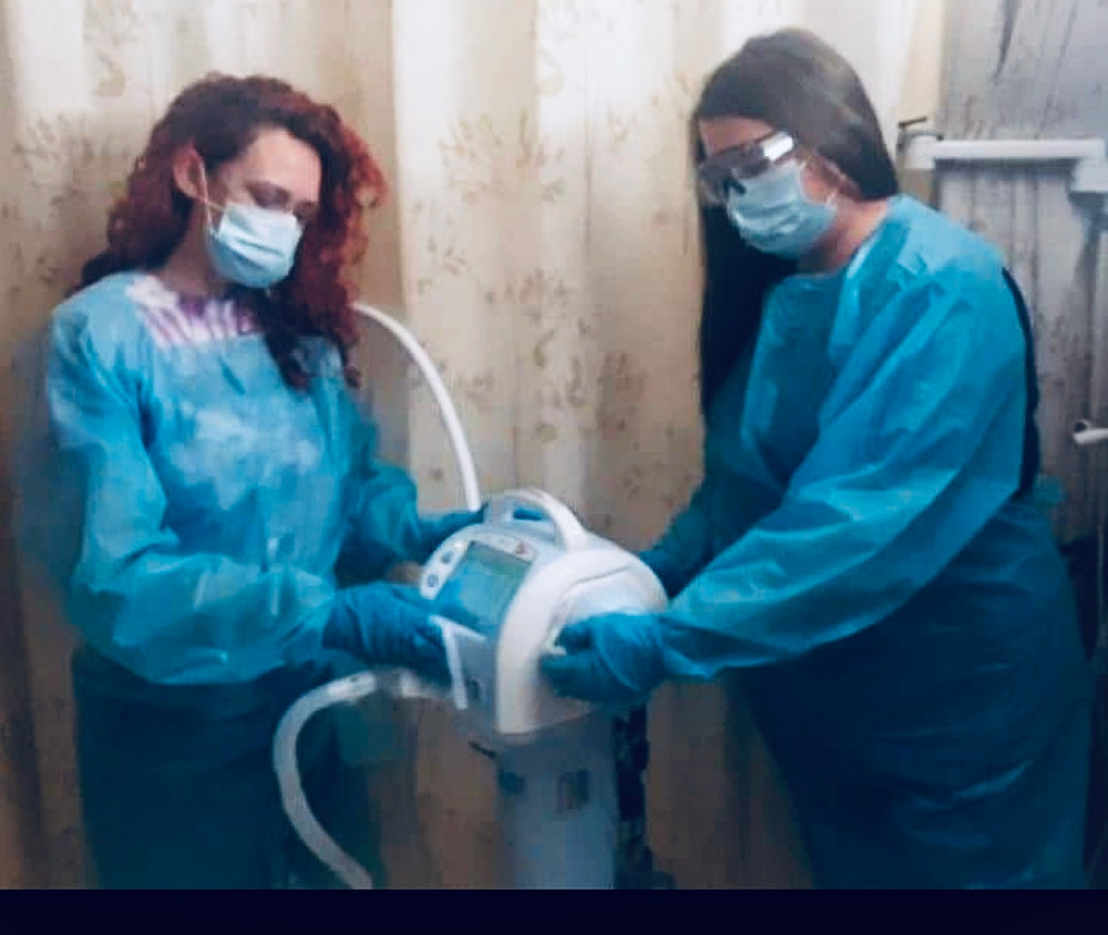 Amber Holt and Amber Dean cleaning a vent