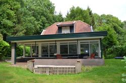 achterkant huis met veranda