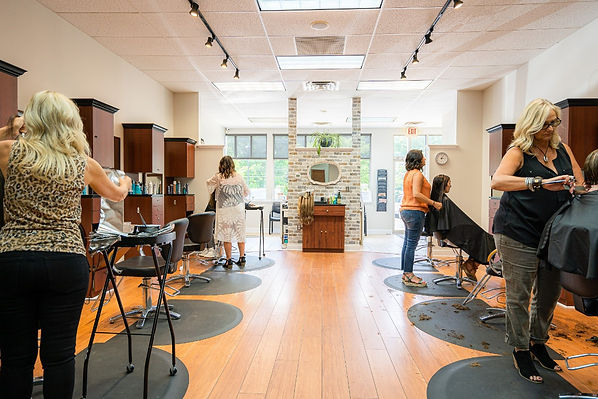 Four hair stylists working at Panache Hair Design in Shelton, CT.