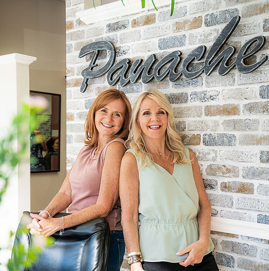 Owners of Panache Hair Salon in Shelton, CT, Jeni Mastrony and Diana Cirillo smiling and laughing.