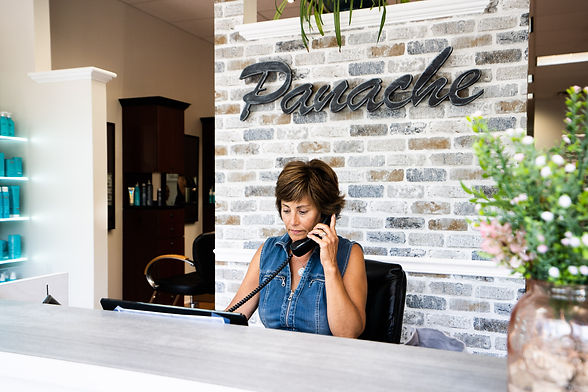 Lisa, the receptionist at Panache Hair Design in Shelton, CT, takes detailed notes as she talks with a client about her hair on the phone.