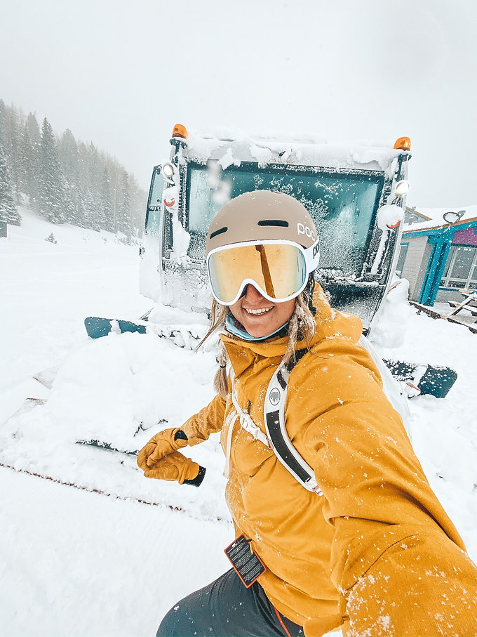 happy skier by snowcat