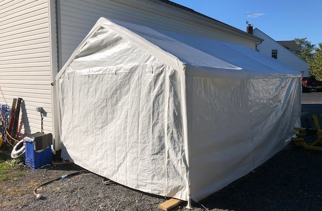 Put up a big tent so I can begin my reassembily and painting!