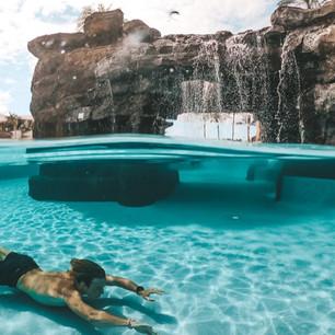 Koloa Guy Swimming Underwater Waterfall.