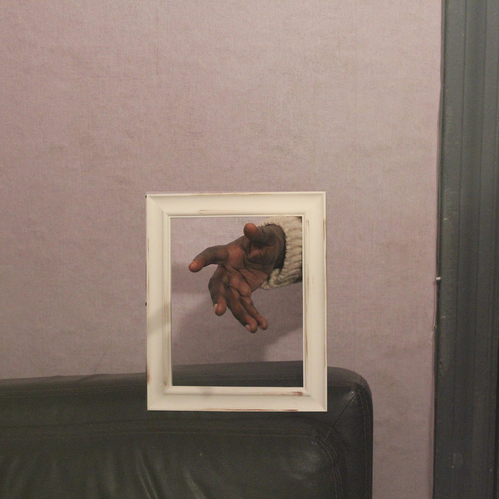 Hand through a Frame