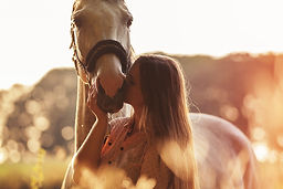 Woman-kissing-her-horse.jpg
