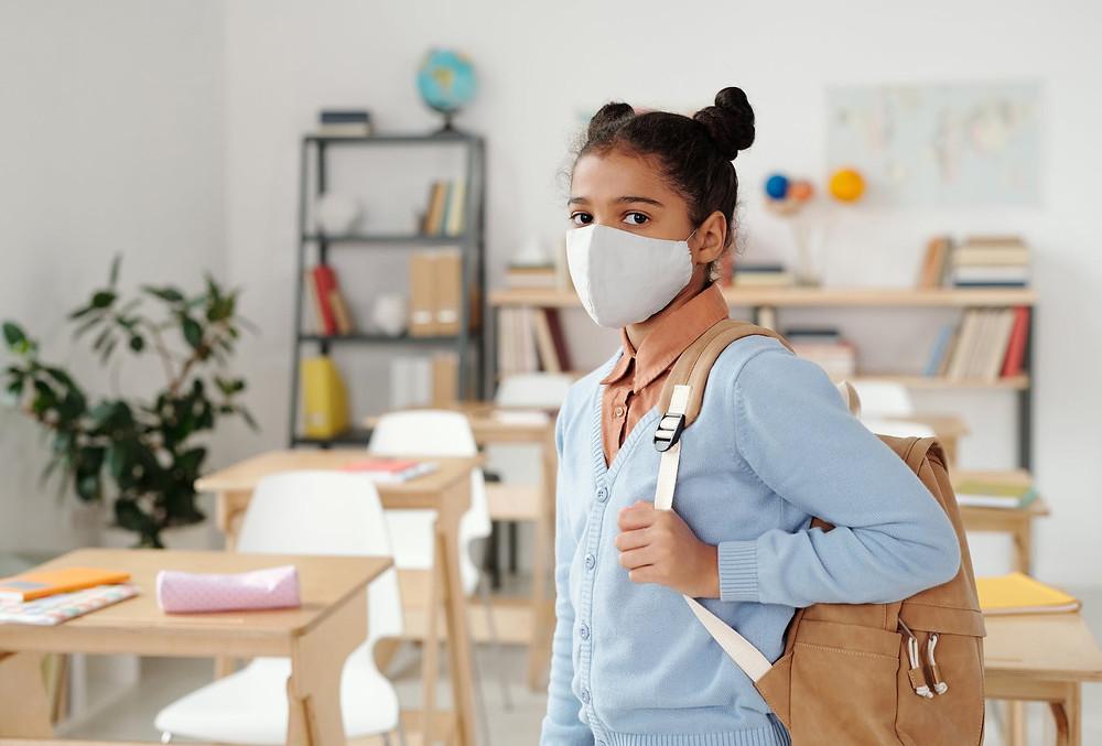 Criança de máscara - Captação de alunos na pandemia. Como fazer?