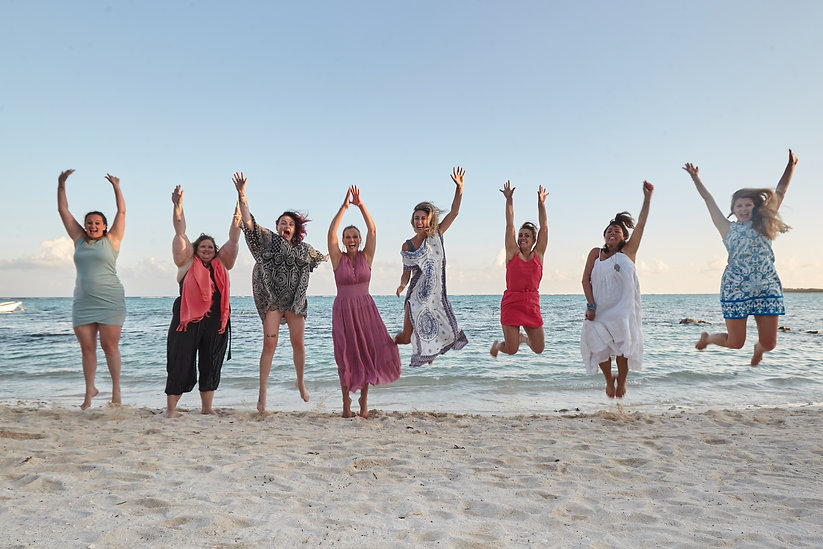 Girls jumping on beach