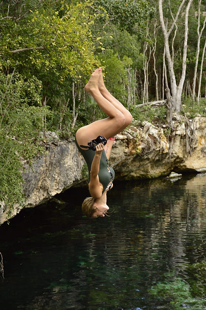 Tamra jumping off cliff