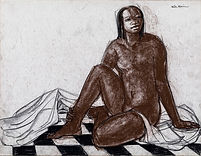 A Malgache seated on the floor, looking up