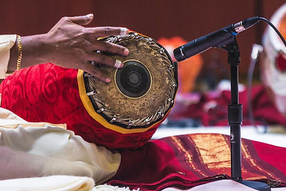 Murugaboopathi playing mridangam in a photo by Vincent Po at Princeton Universit