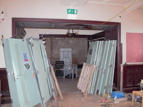 Fire doors removed from 1st floor where there used to be hotel rooms.