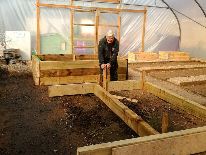 Our caretaker Craig working on the development of the Polytunnel.