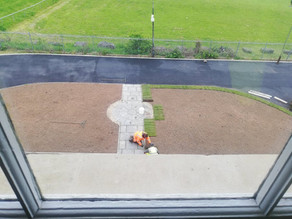 The grass being laid to the entrance of the Hall.
