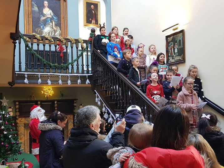 Glan-Yr-Afon staff and children singing at our very first Christmas Fayre.