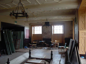 Main entrance with the ground floor room being stripped.