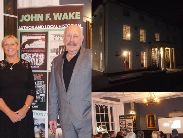 Author John Wake hosting a reading event at the Hall.