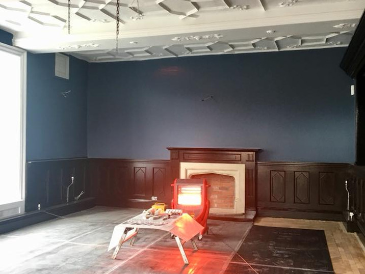 The flooring being repaired in what is now The kemey's Room.