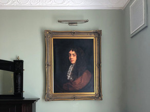 A portrait of a young Captain Morgan on the main staircase.