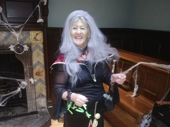 Mary dressed up for Halloween at the Hall.