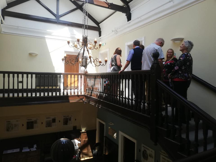 Showing guests around the Hall.