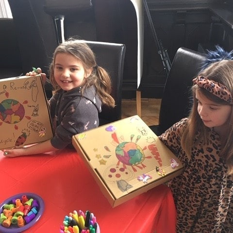 Children doing arts and crafts at a Hall event.
