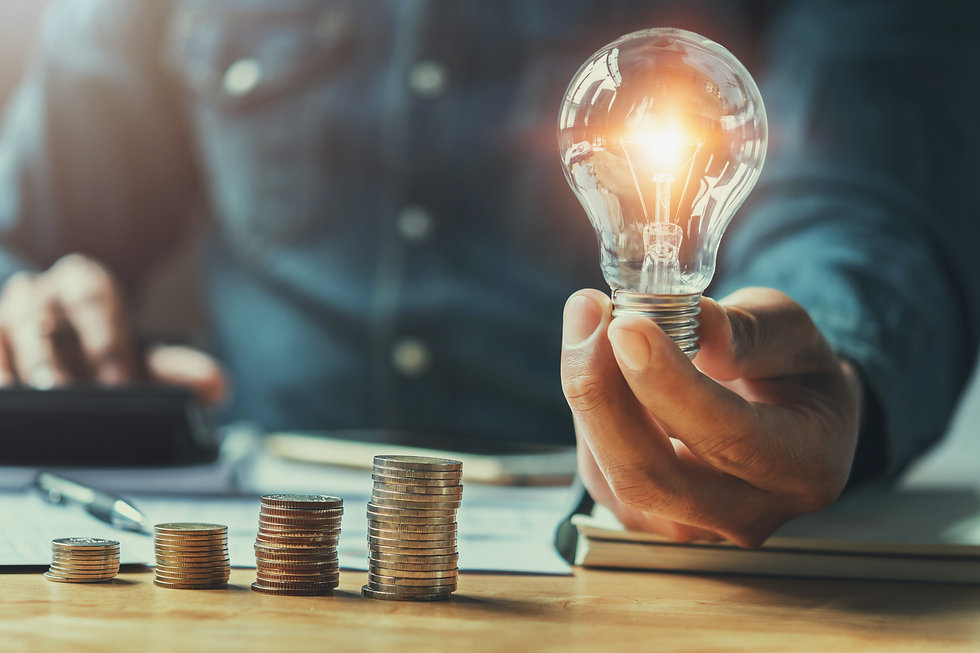 business man hand holding lightbulb with