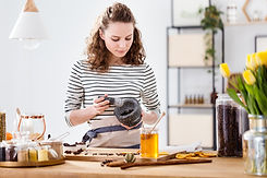 Passionate girl grinding herbs to produc