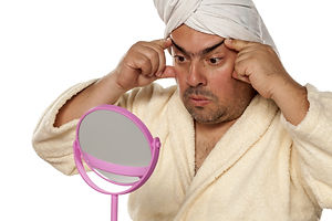 adult man with a towel on his head tight